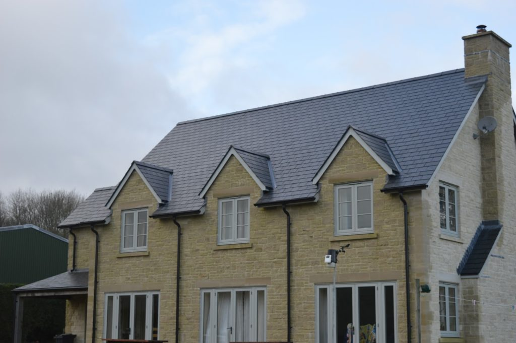 large detached house with Merayo slate roofing